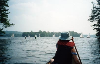 In the canoe among the sail boats